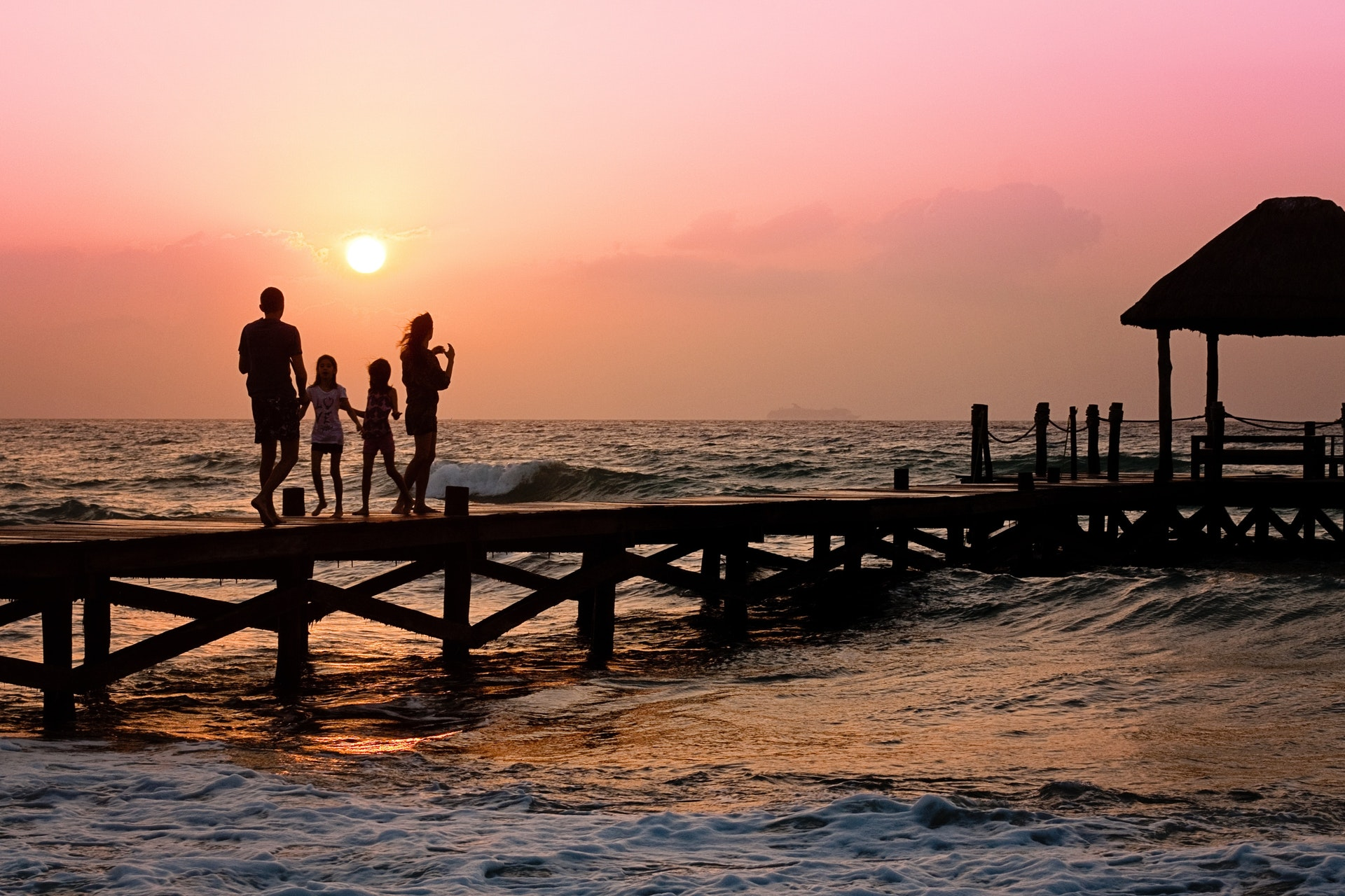 family-pier-man-woman-children